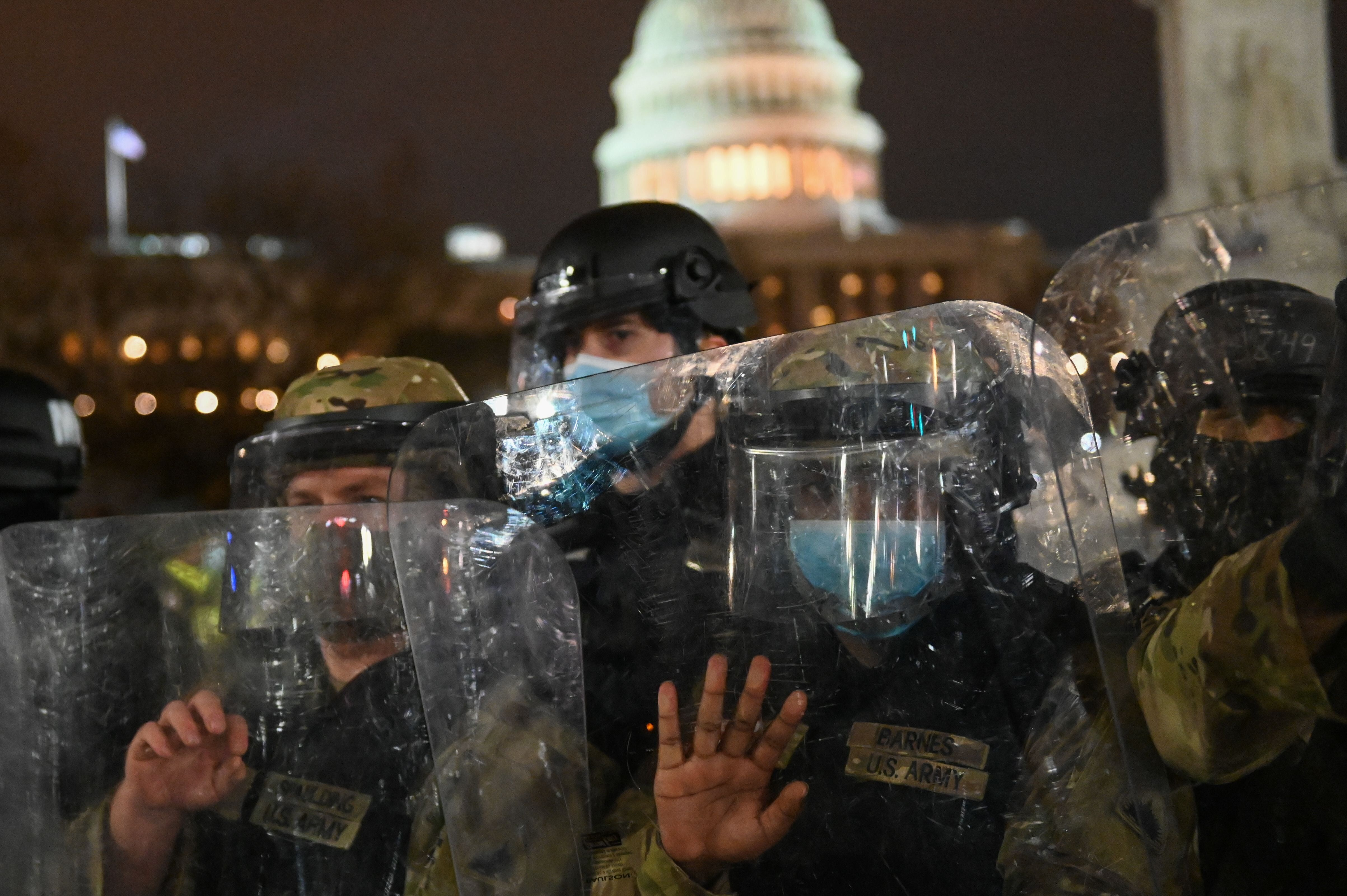 National Guard troops clear a street outside the Capitol building on Jan. 6.