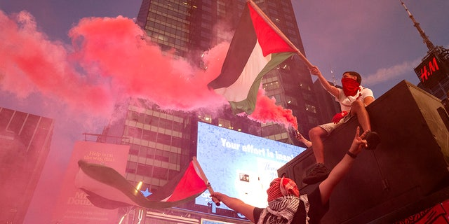 This photo from Thursday May 20, 2021, shows pro-Palestinian protesters during a demonstration in New York's Times Square amid ongoing violence between Israel and Hamas that caused widespread destruction in the Gaza Strip. (AP Photo/Craig Ruttle, File)