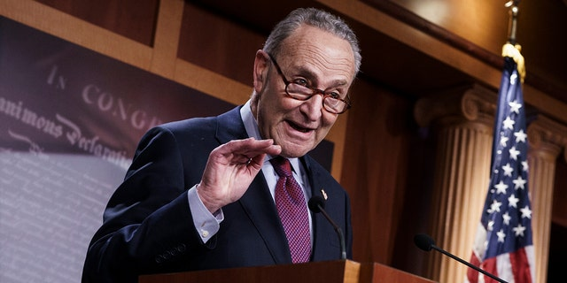 Senate Majority Leader Chuck Schumer, D-N.Y., praises his Democratic Caucus at a news conference just after the Senate narrowly approved a $1.9 trillion COVID-19 relief bill, at the Capitol in Washington, Saturday, March 6, 2021. (AP Photo/J. Scott Applewhite)