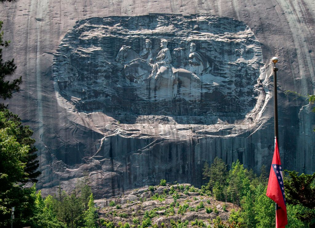 A carving on Stone Mountain honoring Confederate generals is shown on Monday, May 24, 2021, in Stone Mountain, Ga. The Stone