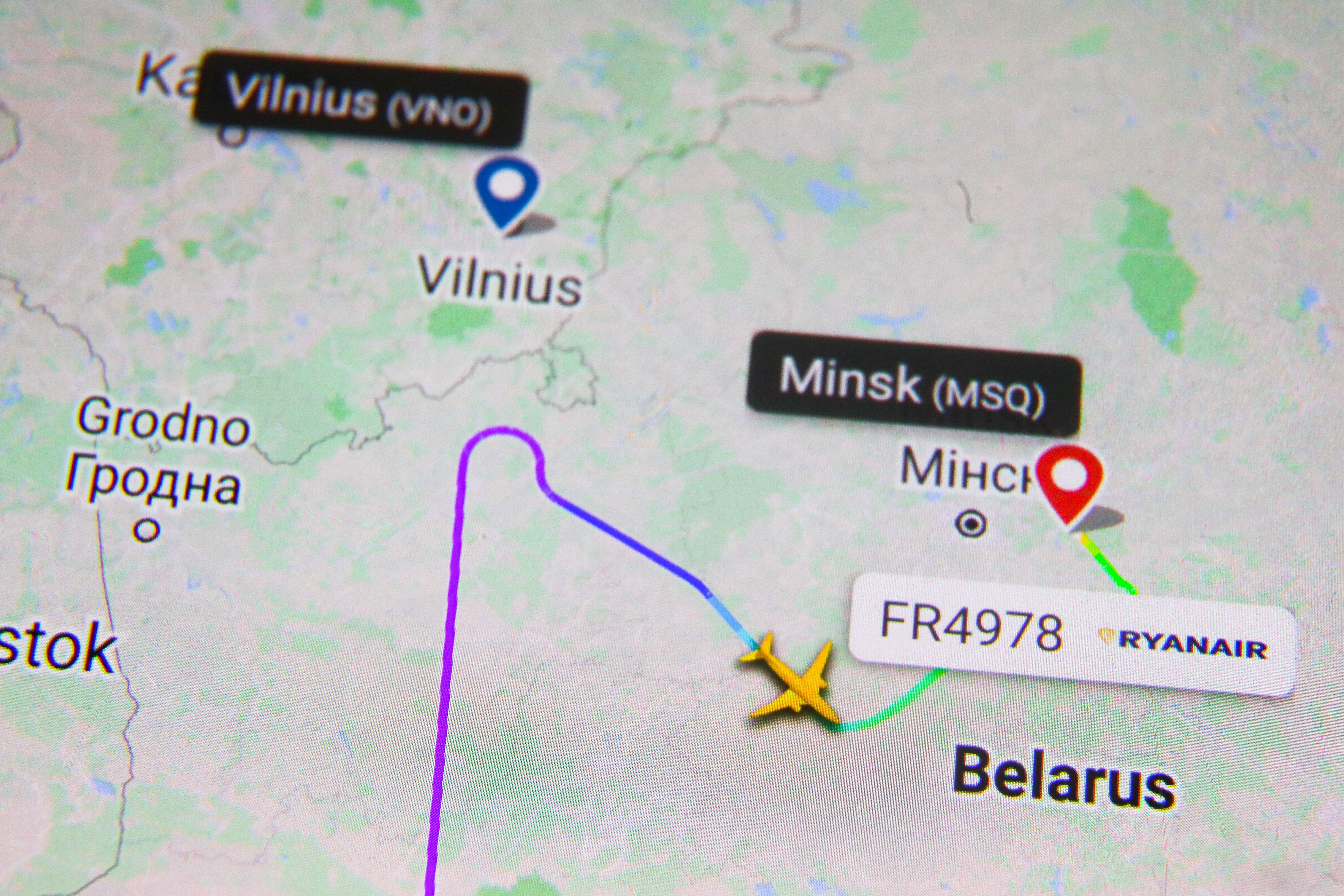 Flight history for Ryanair flight FR4978 shown on Flightradar24 website is displayed on a mobile phone screen photographed fo