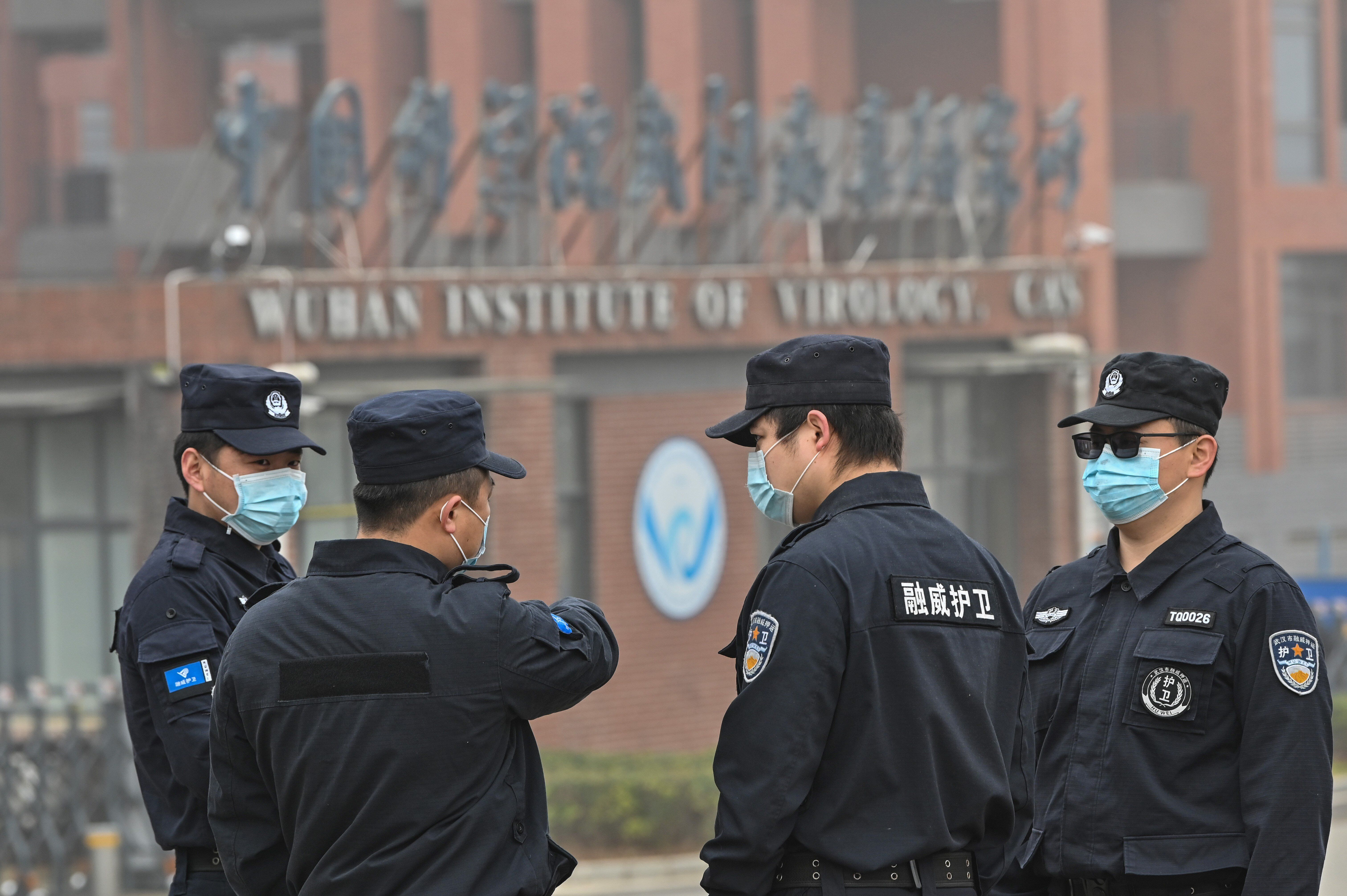 Security personnel outside the Wuhan Institute of Virology in Wuhan, China, on Feb. 3, 2021.