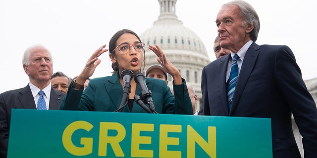 Rep. Alexandria Ocasio-Cortez, D-N.Y., and Sen. Ed Markey (right), D-Mass., speak during a press conference outside the U.S. Capitol in Washington, D.C., on Feb. 7, 2019.to announce Green New Deal legislation.