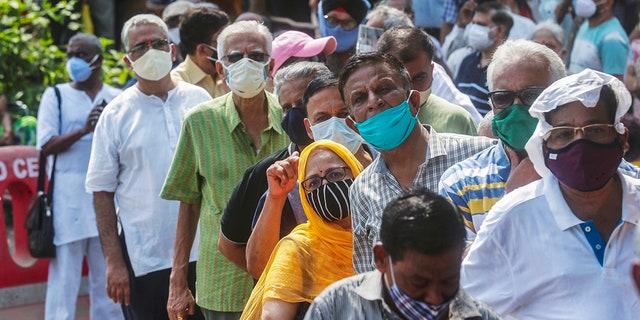 April 26, 2021: In this file photo, people queue up for the coronavirus vaccine in Mumbai, India.