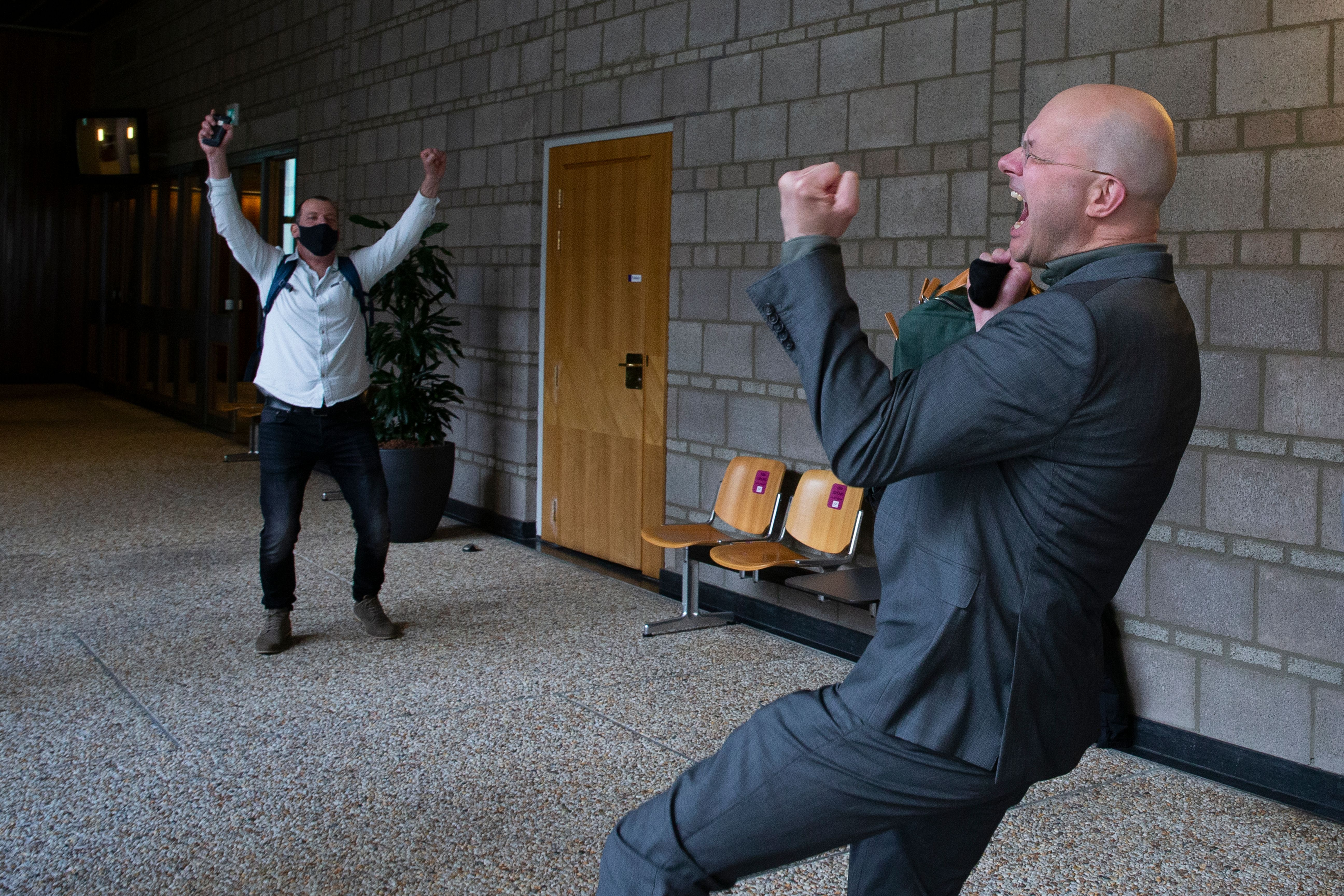Milieudefensie director Donald Pols, right, celebrates the outcome of the verdict in the court case of Milieudefensie, the Du