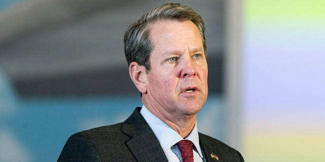 Brian Kemp, governor of Georgia, speaks during a news conference at a mass COVID-19 vaccination site at the Delta Flight Museum in Hapeville, Ga., on Wednesday, Feb. 25, 2021. (Elijah Nouvelage/Bloomberg via Getty Images)