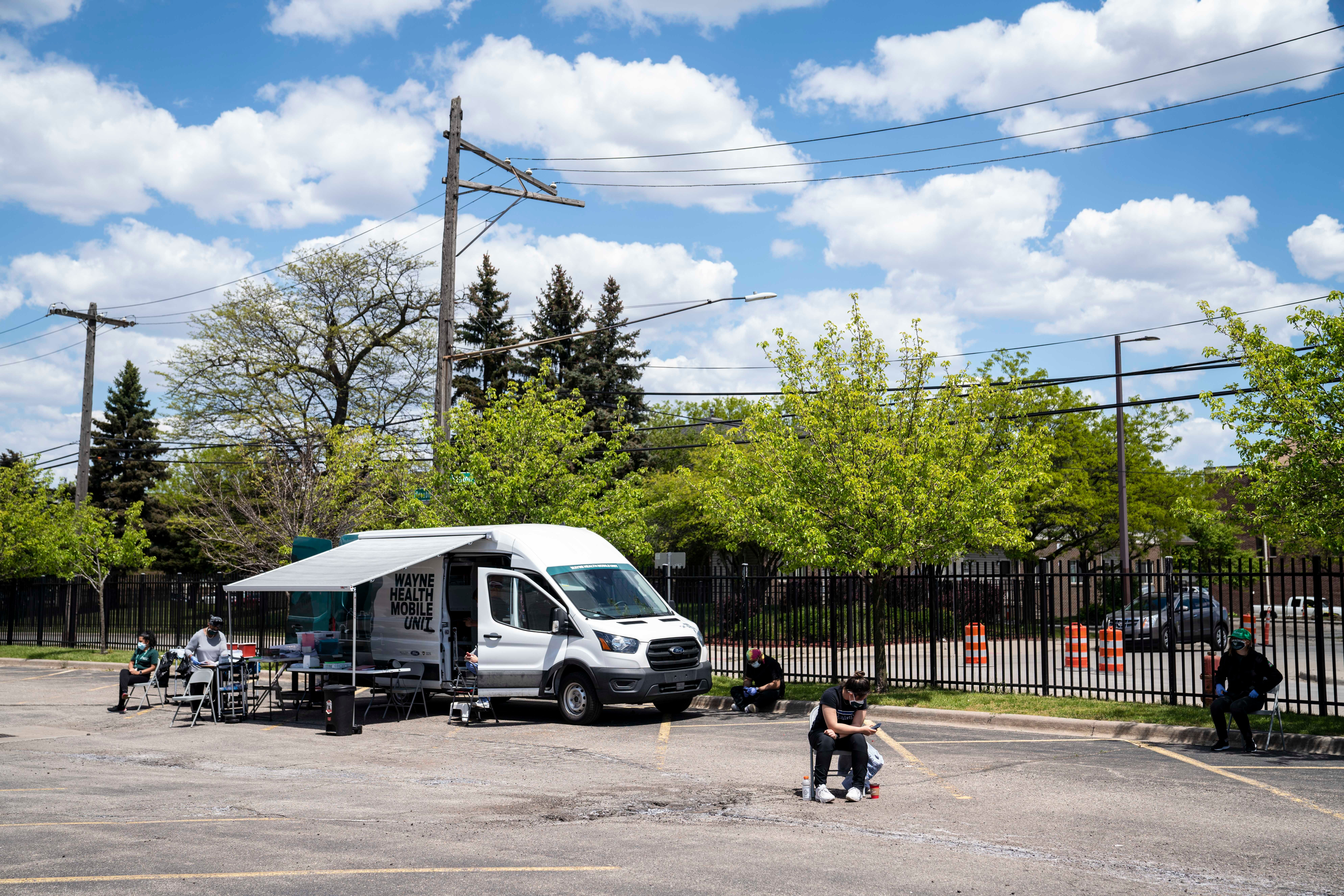 Staff wait for patients who want a COVID-19 vaccine at one of the Wayne Health Mobile Units in Detroit, May 14, 2021. On this