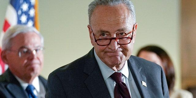 Senate Majority Leader Chuck Schumer of New York walks away following a media availability on Capitol Hill in Washington, Tuesday, May 18, 2021. Sen. Bob Menendez, D-N.J., is at left. (AP Photo/Susan Walsh)