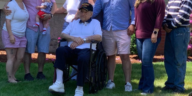 World War II veteran Anthony Grasso with his family in Norwood, Mass. just before he departs to give a final salute to the man who saved his life, Frank DuBose.