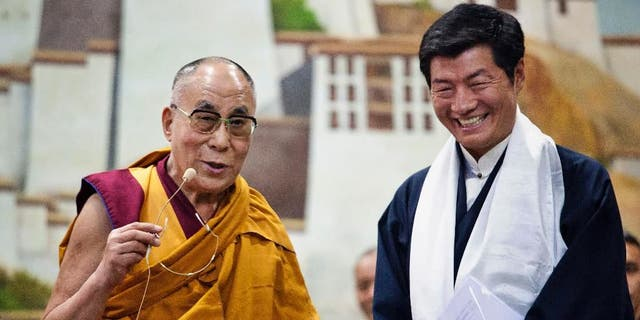 Lobsang Sangay, prime minister of the Tibetan government-in-exile, right, smiles as he listens to spiritual leader the Dalai Lama at the Tibetan Children's Village School in Dharmsala, India, Thursday, June 5, 2014. (AP Photo/Ashwini Bhatia)