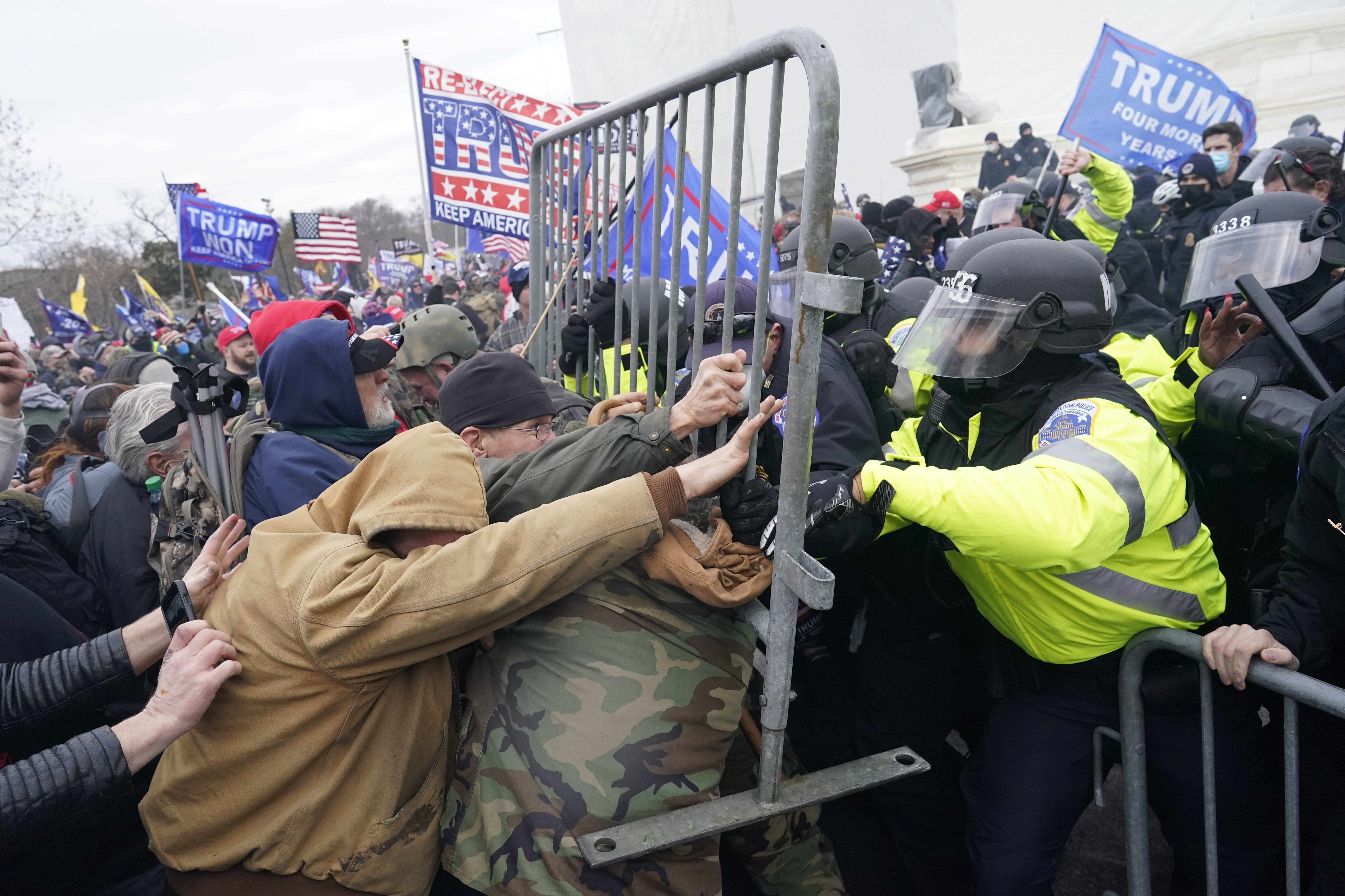 Pro-Trump insurrectionists attack the U.S. Capitol on Jan. 6, intending to stop the counting of electoral votes for Joe Biden