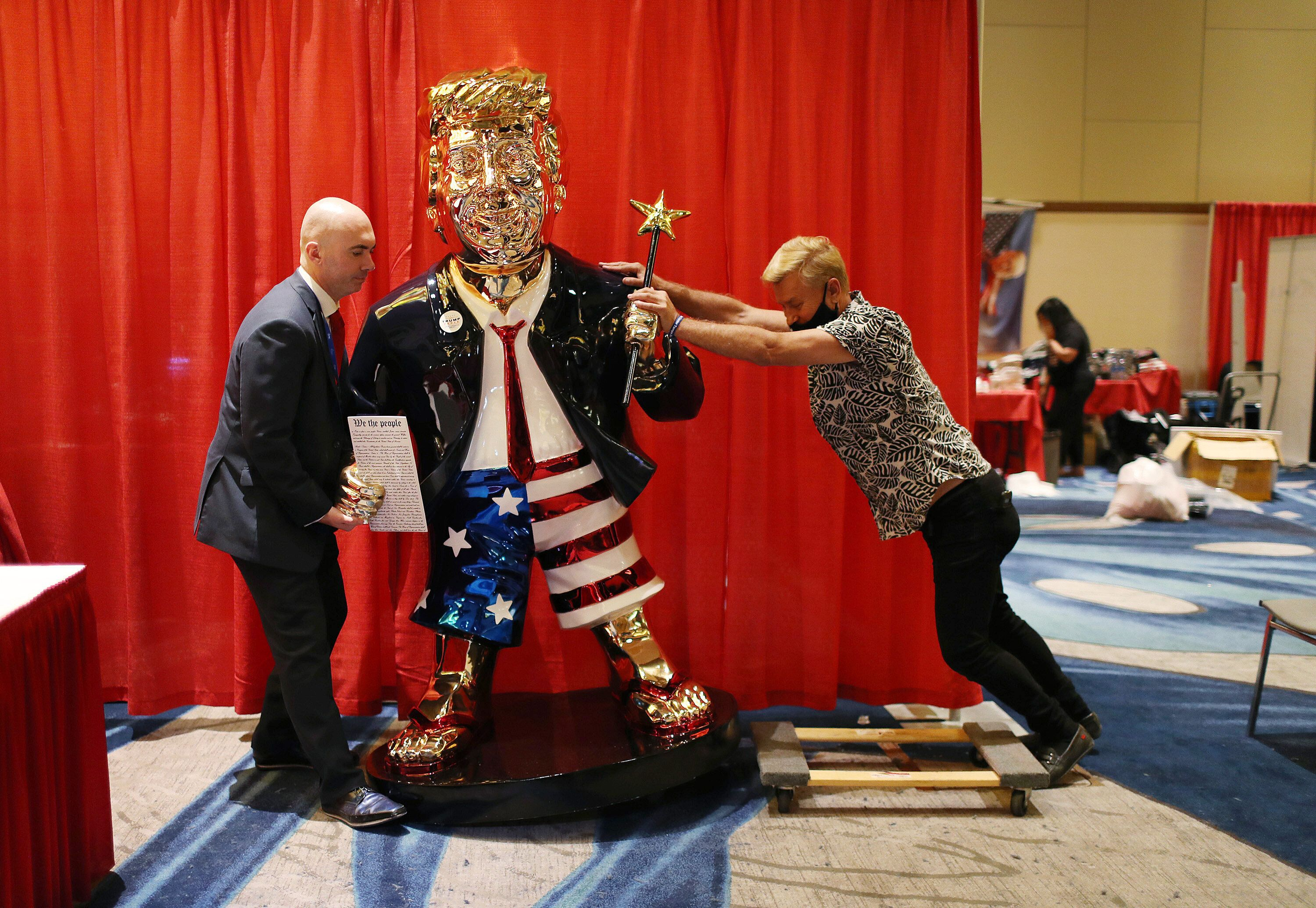 Republicans roll out a golden statue of Donald Trump ahead of his speech to the Conservative Political Action Convention, one