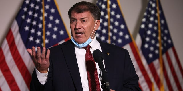 WASHINGTON, DC - NOVEMBER 18: U.S. Sen. Michael Rounds (R-SD) speaks to members of the press as he arrives at a Senate Republican policy luncheon at the Hart Senate Office Building November 18, 2020 on Capitol Hill in Washington, DC. Senate GOP members held a policy luncheon to discuss the Republican agenda. Rounds had to miss a vote on the Jan. 6 commission on May 28, 2021, due to work travel overseas, his spokesperson said. (Photo by Alex Wong/Getty Images)