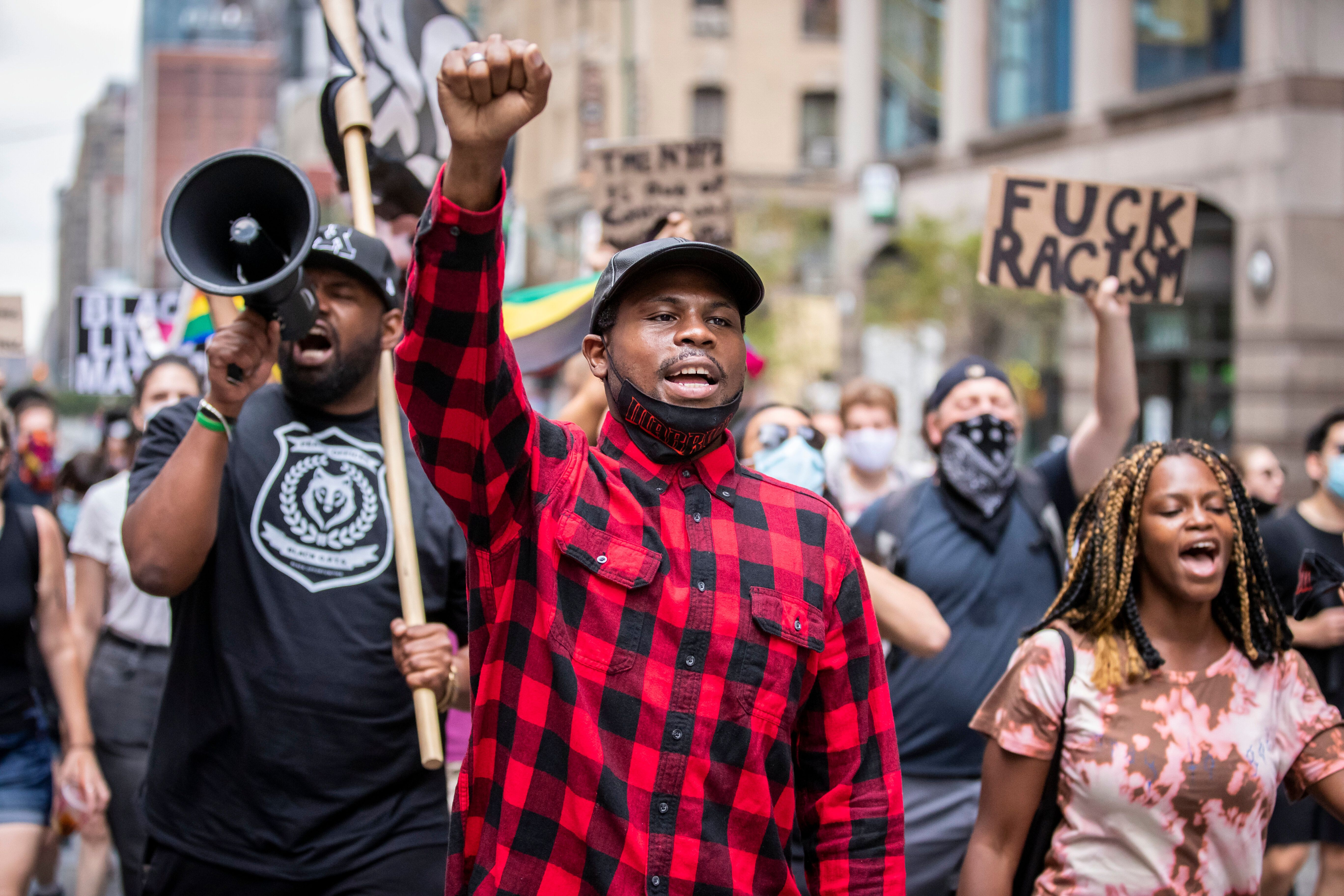 Black Lives Matter protesters march in New York City in August. Proponents of police reform fear losing ground amid rising cr