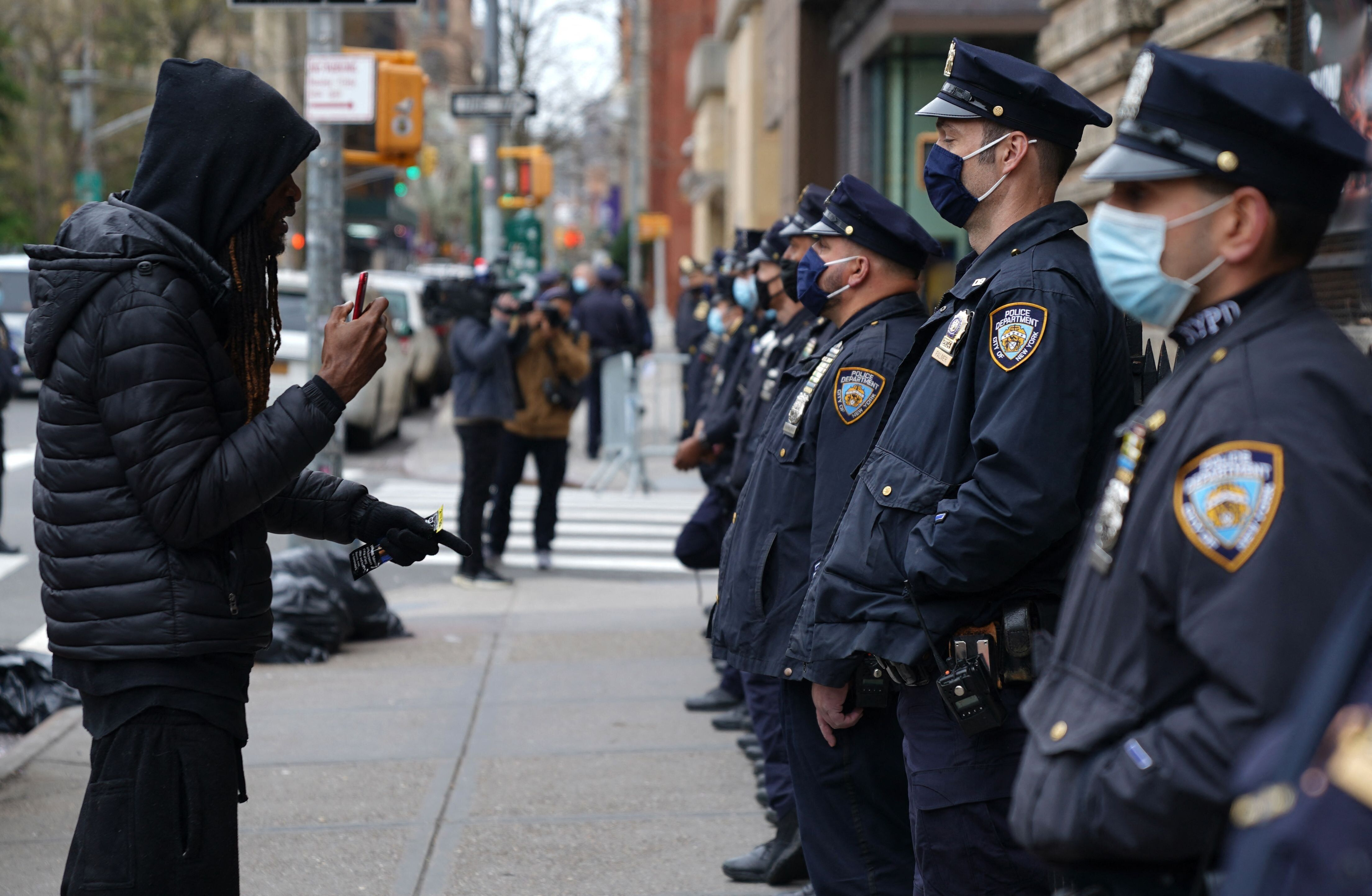 A protester approaches NYPD officers at an April demonstration. NYPD officers say that they do less proactive policing for fe