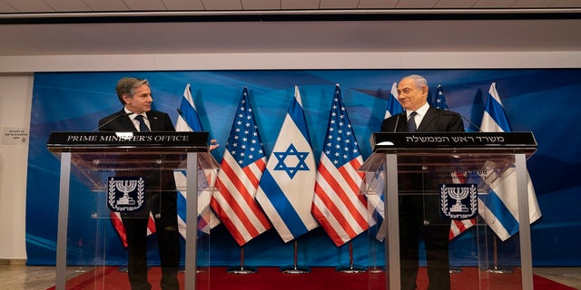 Secretary of State Antony Blinken, left, speaks as Israeli Prime Minister Benjamin Netanyahu listens during a joint statement after a meeting at the Prime Minister's office, Tuesday, May 25, 2021, in Jerusalem, Israel. (AP Photo/Alex Brandon, Pool)