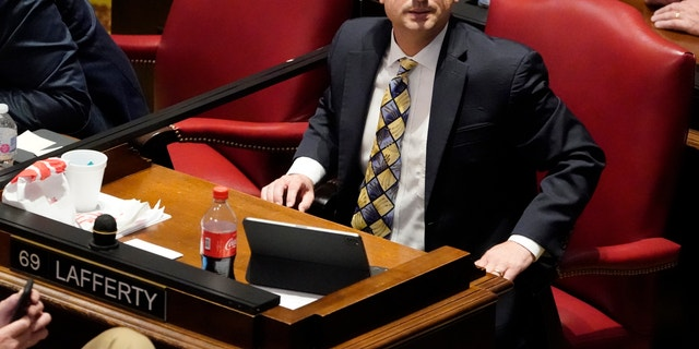 """FILE - In this May 4, 2021, file photo, State Rep. Justin Lafferty, R-Knoxville, watches the tally board during a vote in the House of Representatives in Nashville, Tenn. Lafferty falsely declared that an original constitutional provision designating a slave as three-fifths of a person was adopted for """"the purpose of ending slavery,"""" commenting amid a debate over whether educators should be restricted while teaching about systematic racism in America. (AP Photo/Mark Humphrey, File)"""