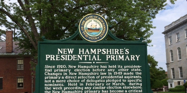 A sign by New Hampshire's state capital building marking the state's century-old tradition of holding the first presidential primary in the race for the White House, in Concord, N.H.