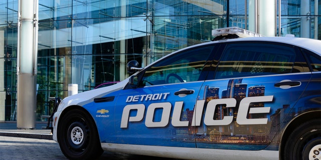 Detroit, Michigan, USA - October 23, 2016: A Detroit Police car parked in front of the Renaissance Center, world headquarters for GM in downtown Detroit (iStock).
