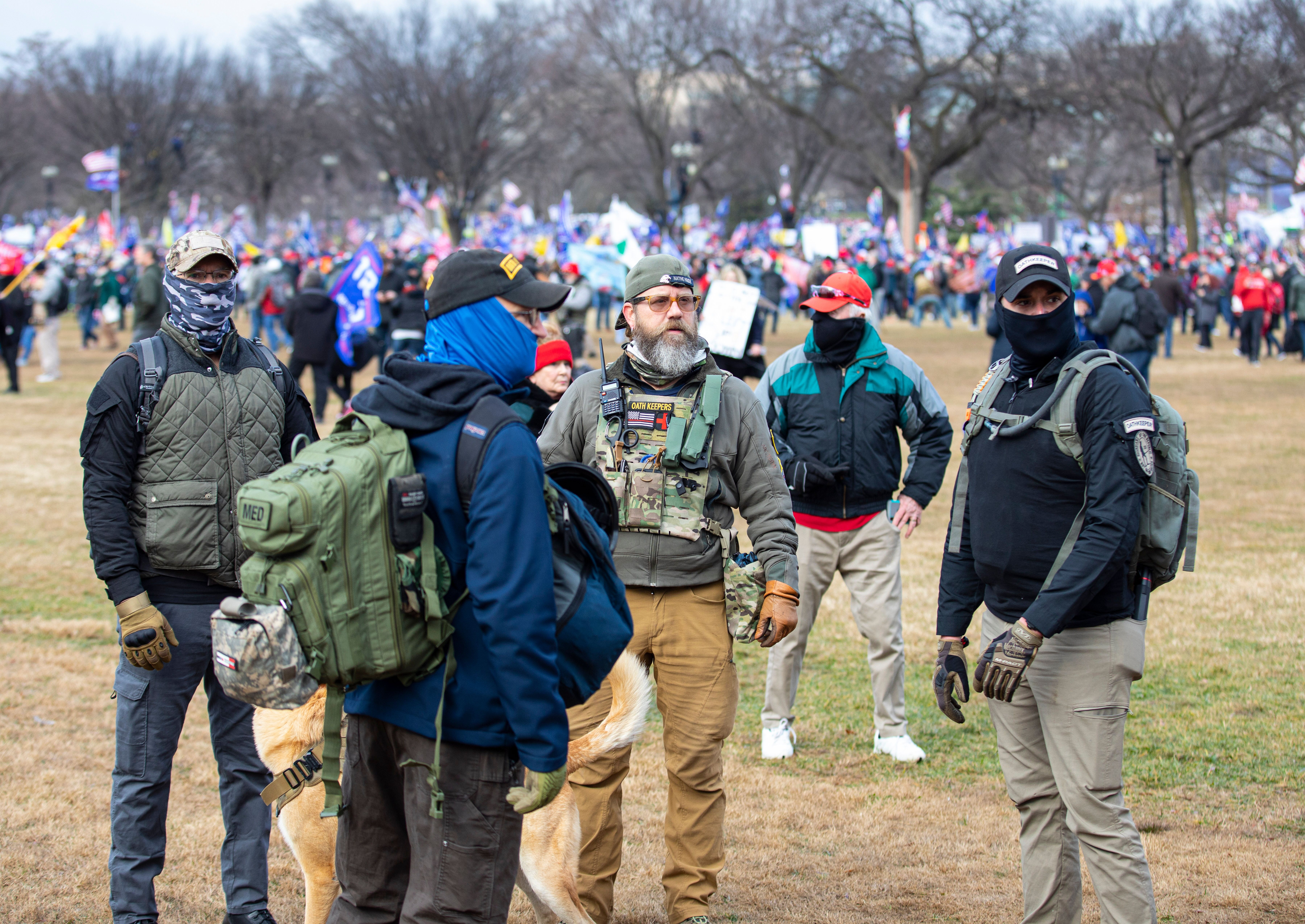 """WASHINGTON, DC - JANUARY 06: Men belonging to the Oath Keepers wearing military tactical gear attend the """"Stop the Steal"""" ral"""