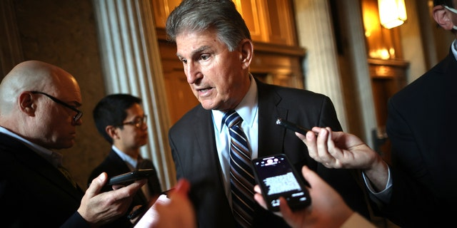 Sen. Joe Manchin, D-W.Va., talks with reporters after stepping off the Senate floor at the U.S. Capitol on May 28, 2021, in Washington, D.C. If Democrats decide to abandon negotiations with Republicans on infrastructure, some GOP senators suggest it will be hard for Democrats to secure votes from Manchin and other moderate Democrats for a bill passed under budget reconciliation. (Chip Somodevilla/Getty Images)