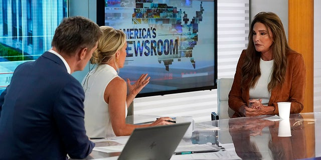 """Caitlyn Jenner, right, a Republican candidate for California governor, is interviewed by co-hosts Bill Hemmer and Dana Perino, on Fox News Channel's """"America's Newsroom"""" television program, Wednesday, May 26, 2021, in New York."""