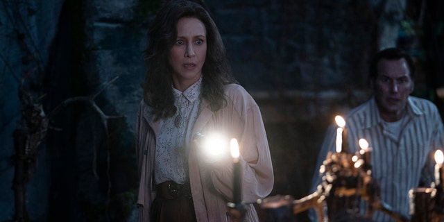 """This image released by Warner Bros. Entertainment shows Vera Farmiga, left, and Patrick Wilson in a scene from """"The Conjuring: The Devil Made Me Do It."""""""