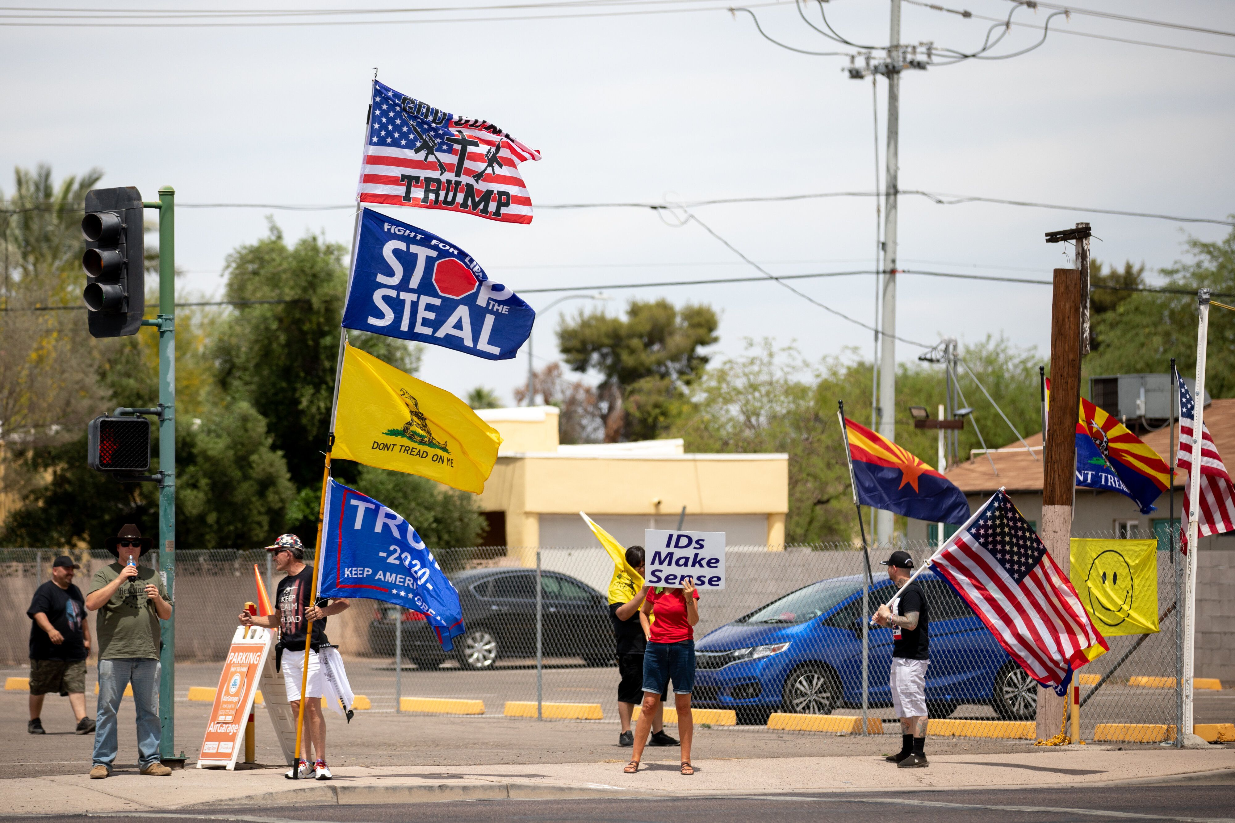 Protestors in support of former President Donald Trump gather outside Veterans Memorial Coliseum in Phoenix, Arizona, on May