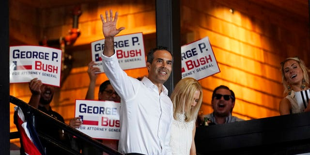 Texas Land Commissioner George P. Bush arrives for a kickoff rally with his wife, Amanda, to announce he will run for Texas attorney general, Wednesday, June 2, 2021, in Austin, Texas. (AP Photo/Eric Gay)
