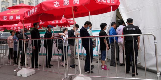 Residents line up outside a vaccination center in Beijing on Wednesday, June 2, 2021. After a slow start, China is now doing what virtually no other country in the world can: harnessing the power and all-encompassing reach of its one-party system and a maturing domestic vaccine industry to administer shots at a staggering pace. (AP Photo/Ng Han Guan)