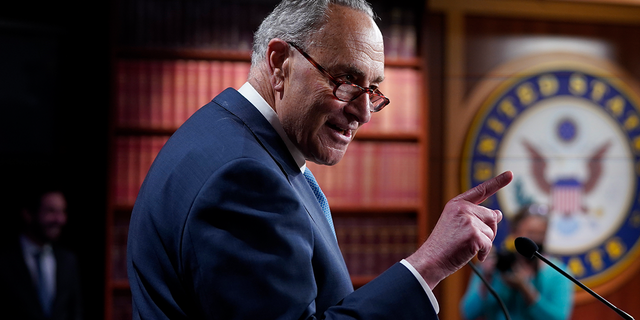 Senate Majority Leader Chuck Schumer, D-N.Y., speaks to reporters after final votes going into the Memorial Day recess, at the Capitol in Washington, Friday, May 28, 2021. Schumer has continued to say Democrats are keeping budget reconciliation as an option to pass an infrastructure bill. (AP Photo/J. Scott Applewhite)