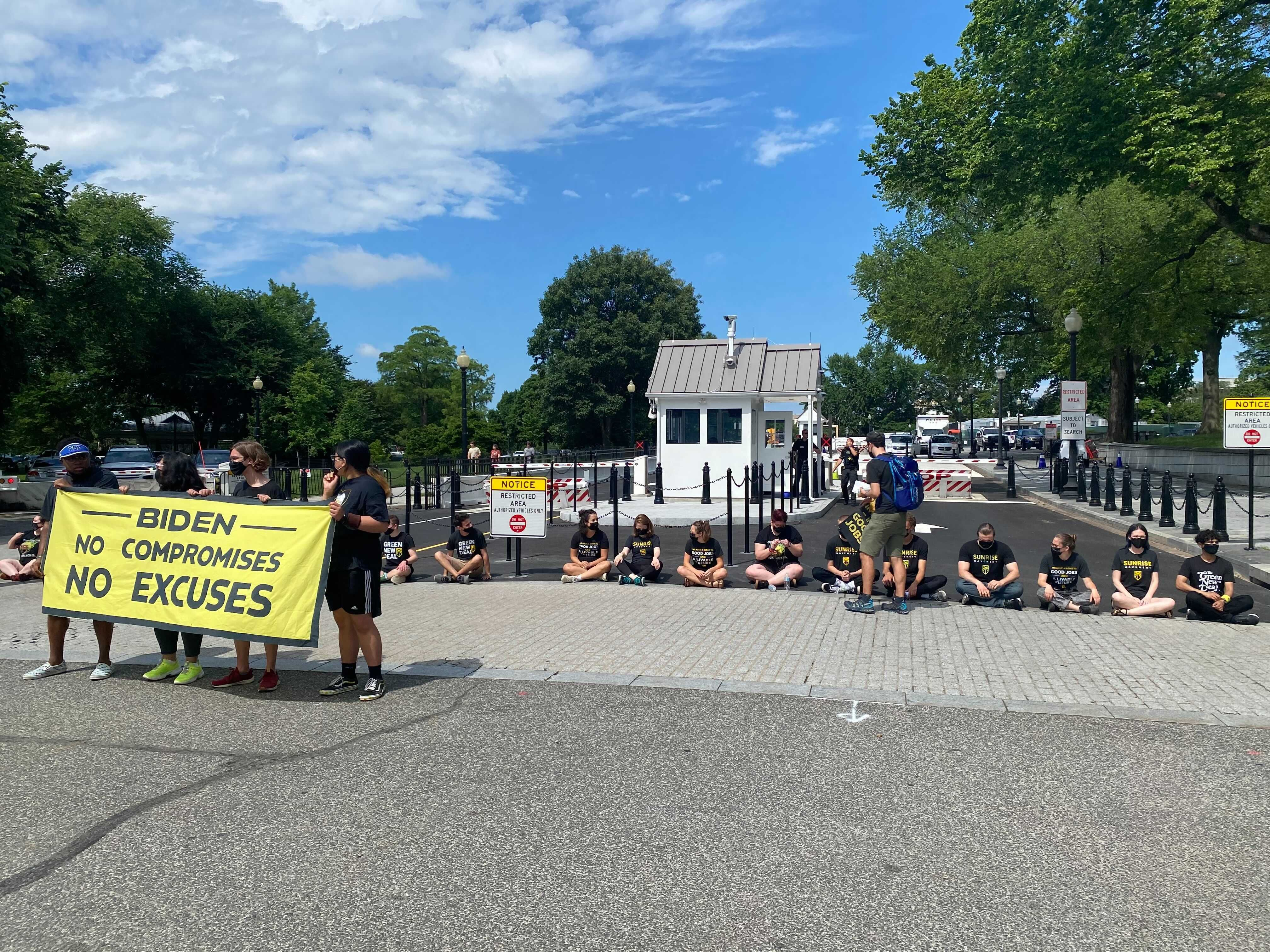 Sunrise Movement protesters blocked the entrance to the White House.