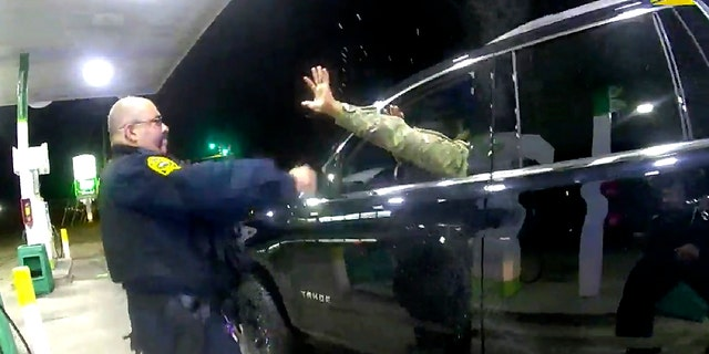 In this image made from Windsor, Va., police video, a police officer uses a spray agent on Army 2nd Lt. Caron Nazario on Dec. 20, 2020, in Windsor. (Windsor Police via AP)