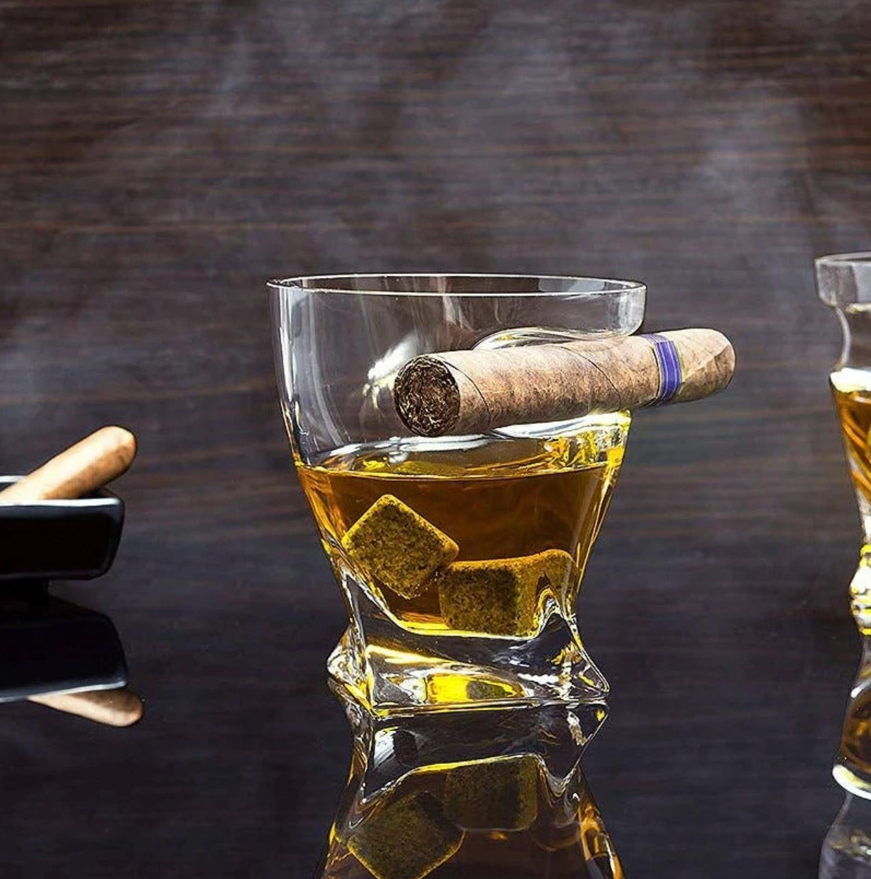 A glass of whiskey paired with a cigar is paradise to some dads, but trying to hold both while gesticulating can be awkward.