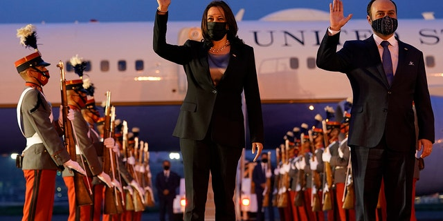 Vice President Kamala Harris and Guatemala's Minister of Foreign Affairs Pedro Brolo wave at her arrival cermony in Guatemala City, Sunday, June 6, 2021, at Guatemalan Air Force Central Command. (AP Photo/Jacquelyn Martin)
