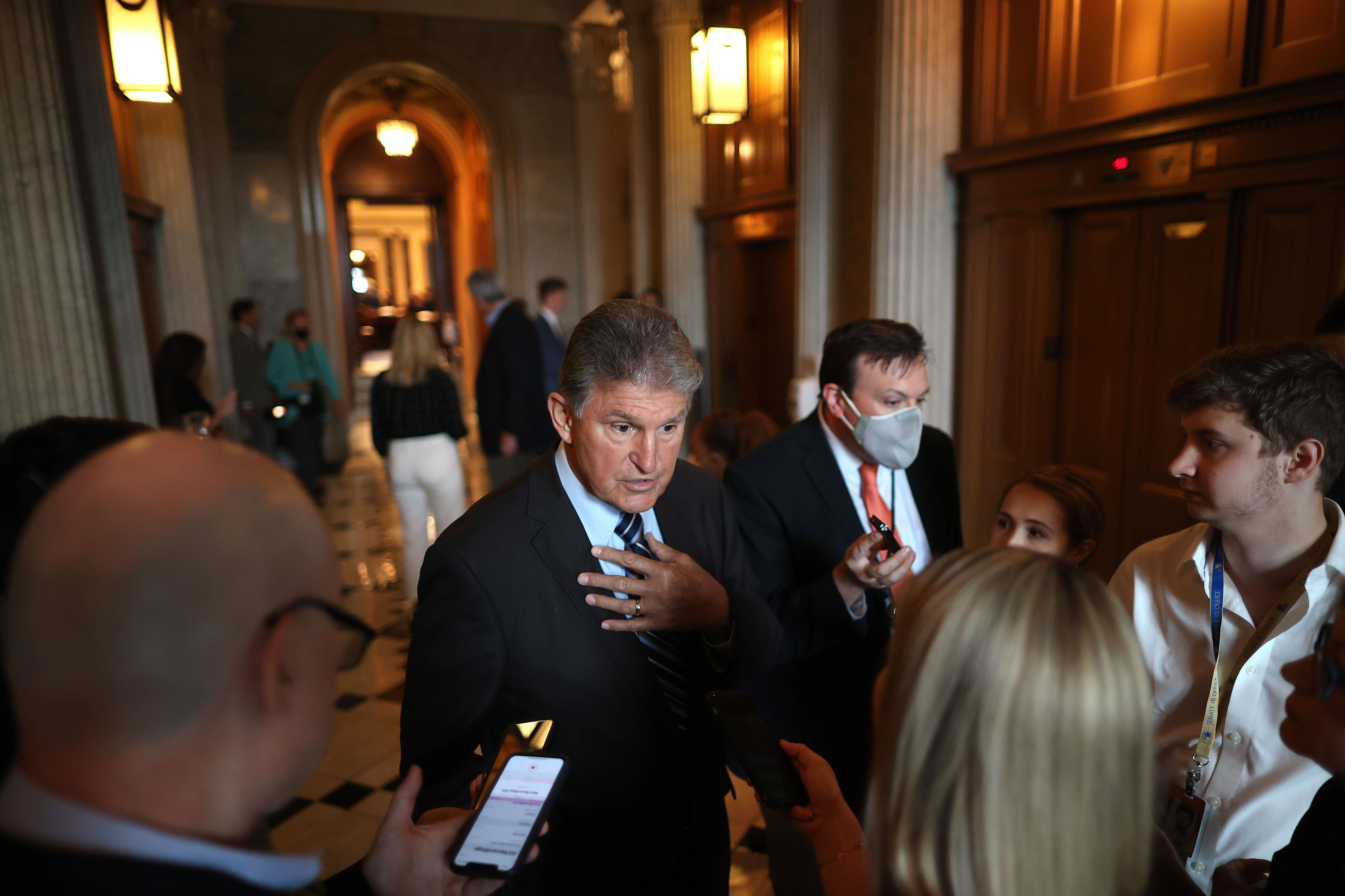 Sen. Joe Manchin (D-WV) talks with reporters after stepping off the Senate Floor at the U.S. Capitol on May 28, 2021 in Washi