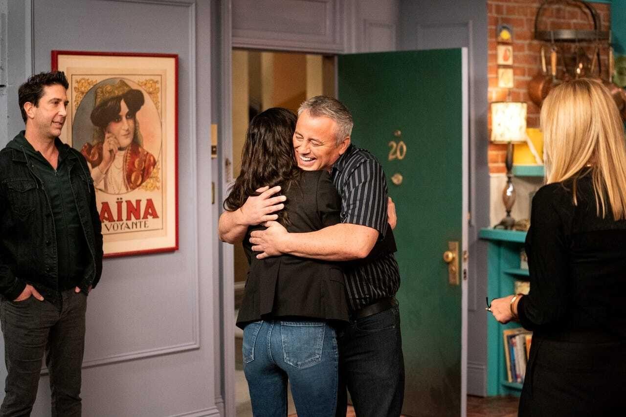 "Matt LeBlanc and Courteney Cox embrace on the set of the ""Friends"" reunion."