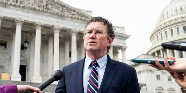 Rep. Thomas Massie, R-Ky., stops to speak with reporters as he leaves the Capitol after the Coronavirus Aid, Relief, and Economic Security Act was passed in the House on Friday, March 27, 2020. (Photo By Bill Clark/CQ-Roll Call, Inc via Getty Images)