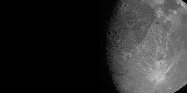 """This June 7, 2021 image made available by NASA shows the Jovian moon Ganymede as the Juno spacecraft flies by. """"This is the closest any spacecraft has come to this mammoth moon in a generation,"""" said Juno's lead scientist, Scott Bolton of the Southwest Research Institute in San Antonio. (NASA/JPL-Caltech/SwRI/MSSS via AP)"""