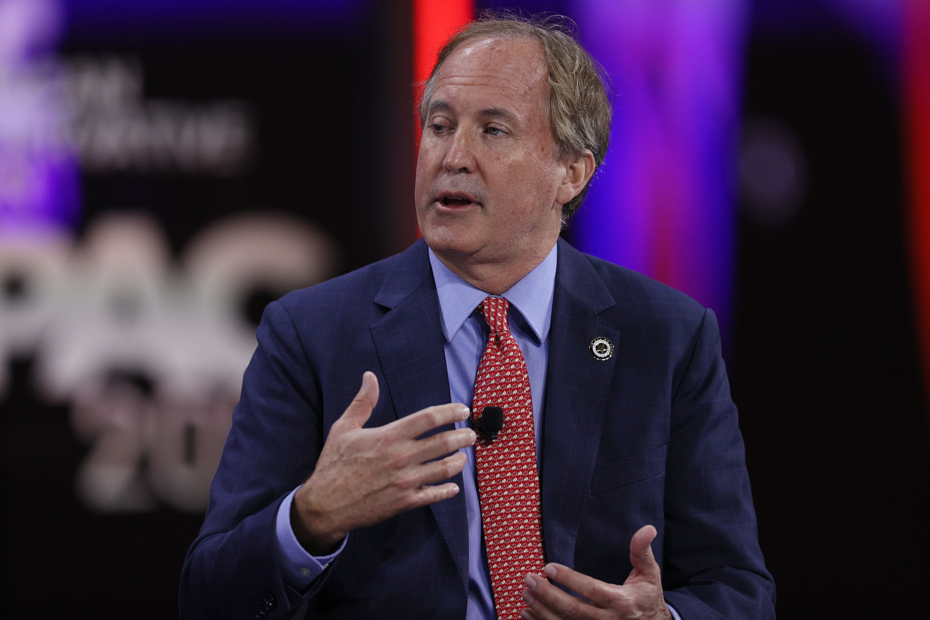 Ken Paxton, Texas Attorney General, speaks during a panel discussion about the Devaluing of American Citizenship during the C