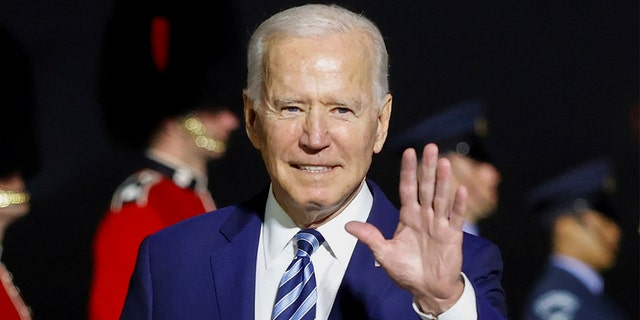 President Joe Biden waves on his arrival on Air Force One at Cornwall Airport Newquay, in Newquay, England, ahead of the G-7 summit, Wednesday, June 9, 2021. (Phil Noble/Pool Photo via AP)