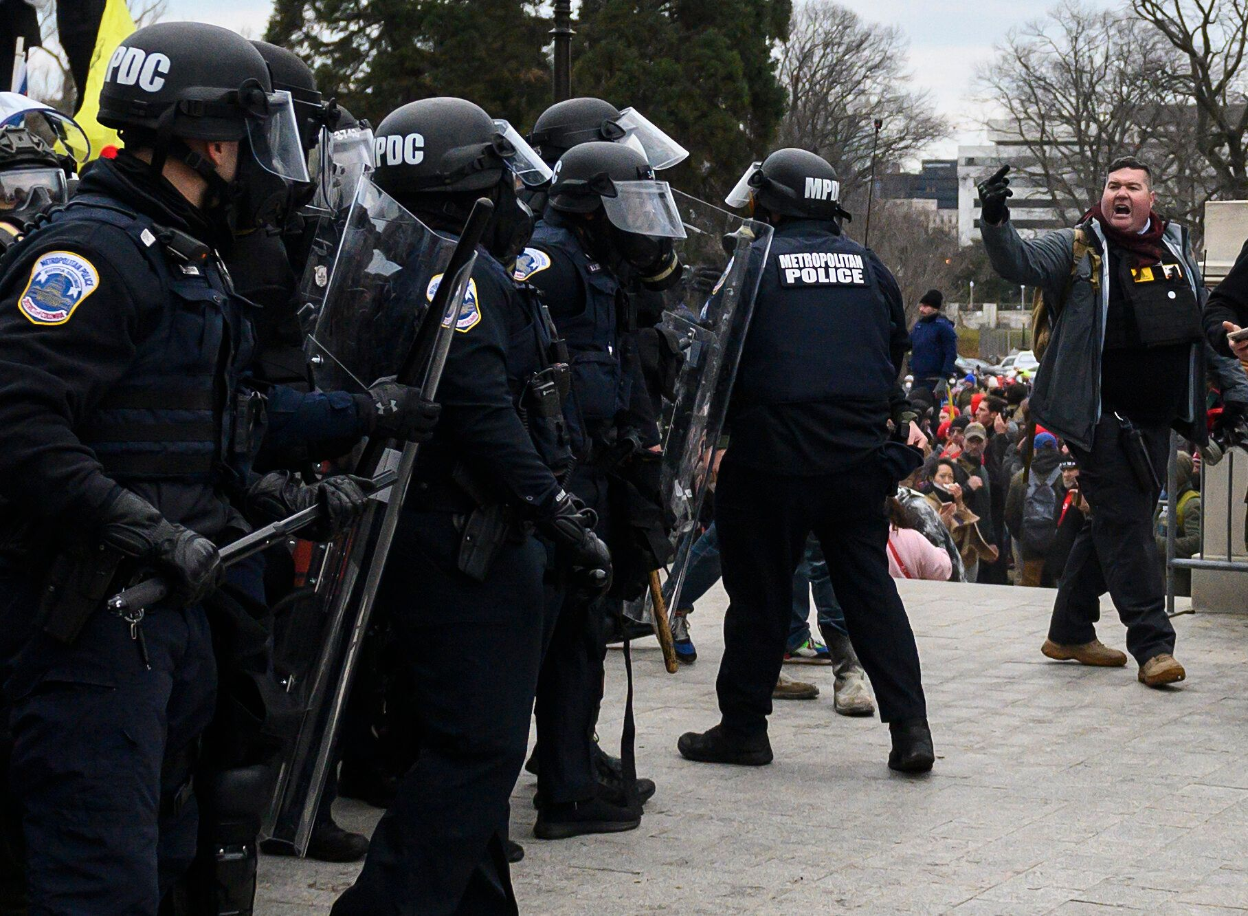 Russ Taylor, right, flips off cops at the Capitol.
