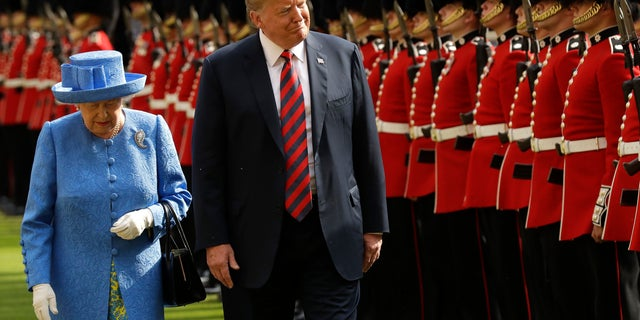 In this July 13, 2018, file photo, U.S. President Donald Trump and Britain's Queen Elizabeth II inspect a Guard of Honour, formed of the Coldstream Guards at Windsor Castle in Windsor, England. (AP Photo/Matt Dunham, Pool, File)
