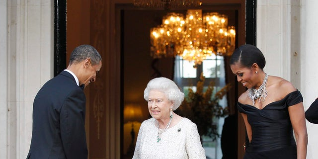In this May 25, 2011, file photo, U.S. President Barack Obama and first lady Michelle Obama welcome Queen Elizabeth II for a reciprocal dinner at Winfield House in London. (AP Photo/Charles Dharapak, File)