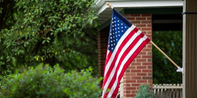 Americans who observe Flag Day often display the national flag in a prominent location. (iStock)