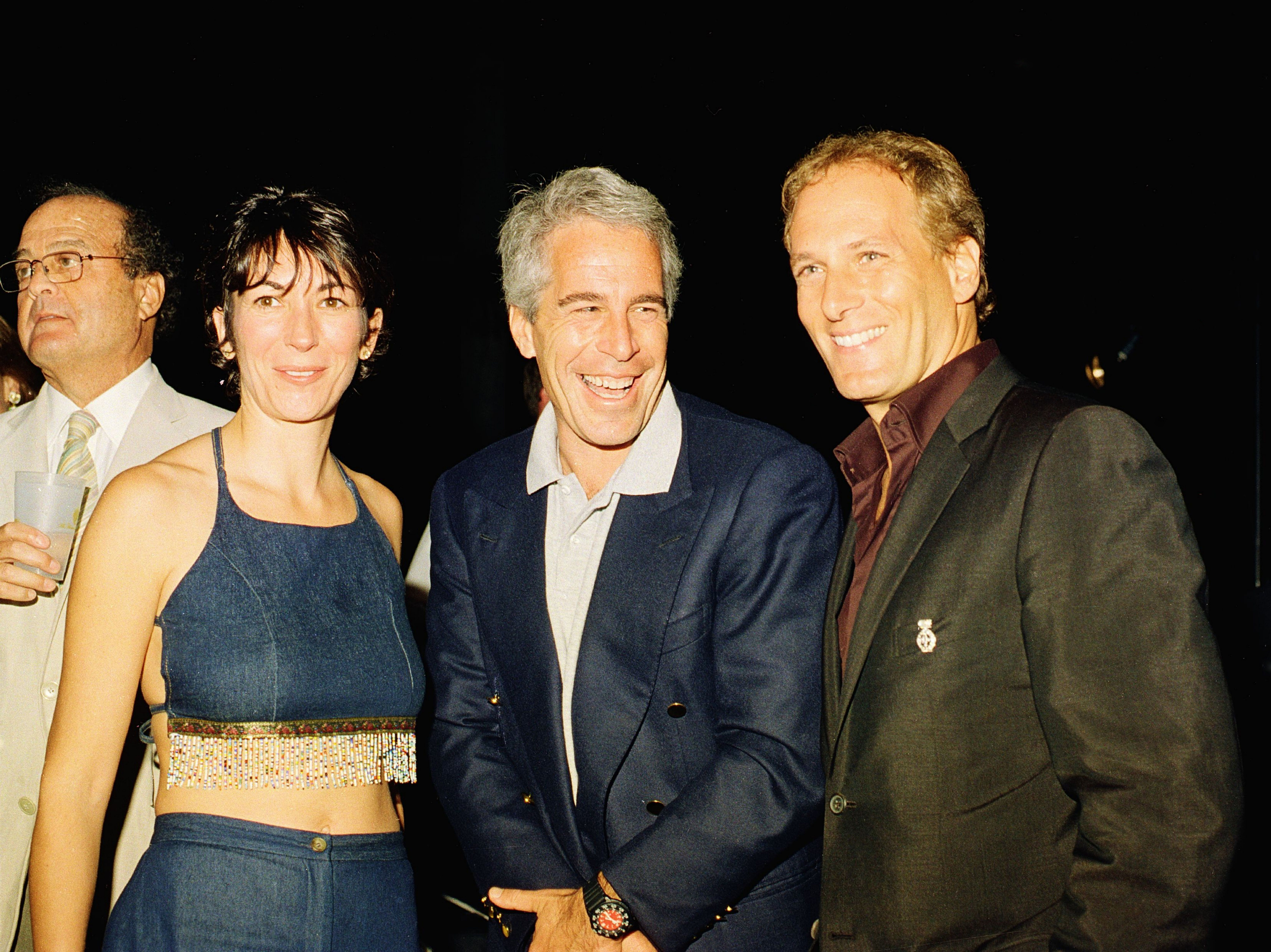 Ghislaine Maxwell and Jeffrey Epstein are seen during a party at ex-President Donald Trump's Mar-a-Lago club in Florida in 20
