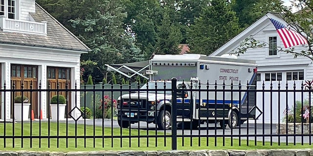 A Connecticut State Police truck is seen outside a Westport home where the bodies of a mother and daughter were found Thursday. (Connor Ryan/Fox News)