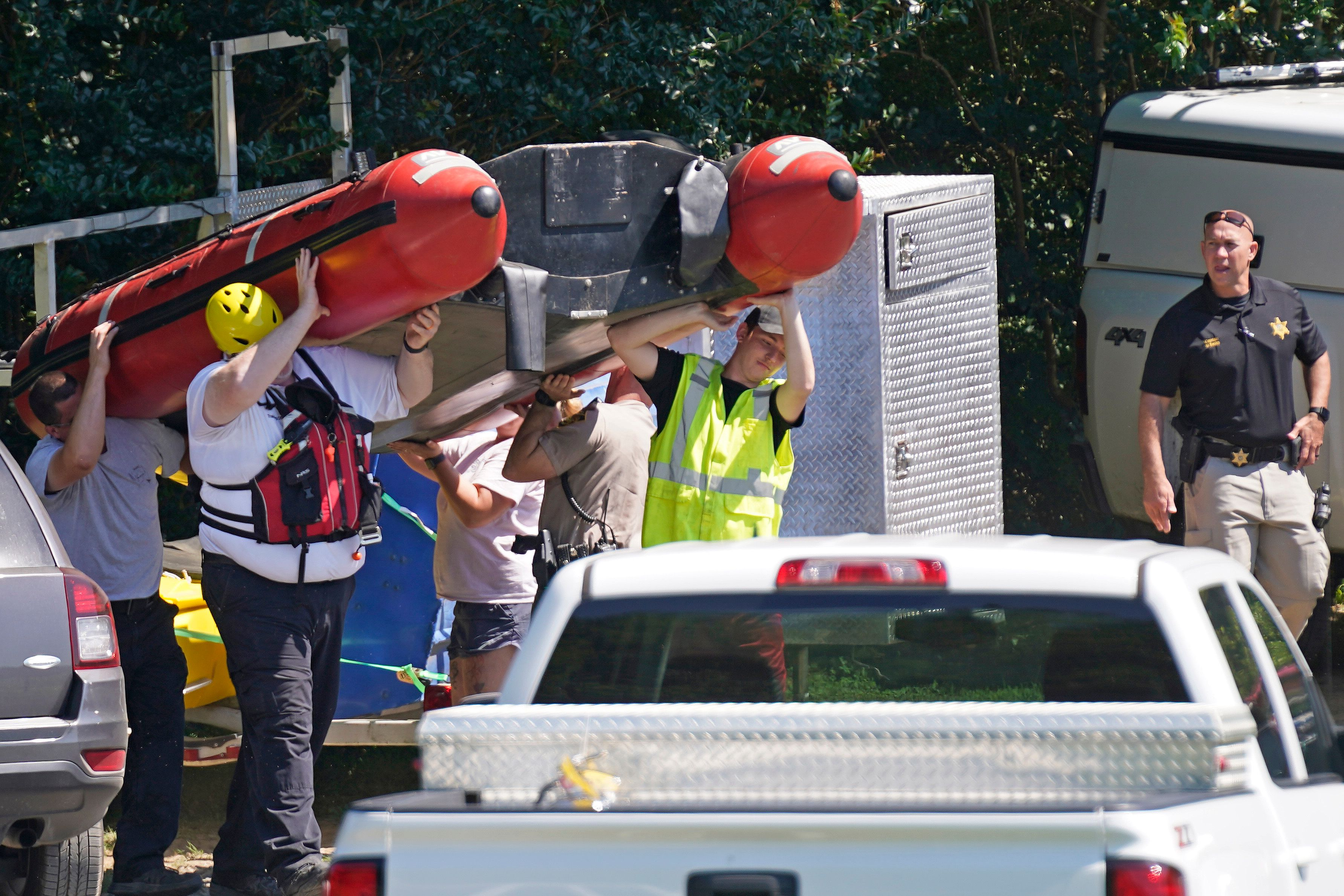 Rescue personnel stage along the Dan River in Eden, N.C., Friday, June 18, 2021. (AP Photo/Gerry Broome)