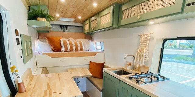 Now that it's been renovated, the 70-square-foot van has a queen-size mattress that turns into a futon during the day, as well as running water, a compostable toilet and a propane stove. (SWNS)