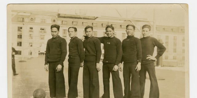 In this 1926 photo provided by the Rita M. Cacas Filipino American Community Archives, University of Maryland, are Filipino sailors in athletic uniforms at US Naval Academy in Annapolis, Maryland. Asian Americans, veterans and civilians in the U.S. and the Philippines are campaigning to name a Navy warship for a Filipino sailor who bravely rescued two crew members when their ship caught fire more than century ago, earning him a prestigious and rare Medal of Honor. (Rita M. Cacas Filipino American Community Archives, University of Maryland via AP)